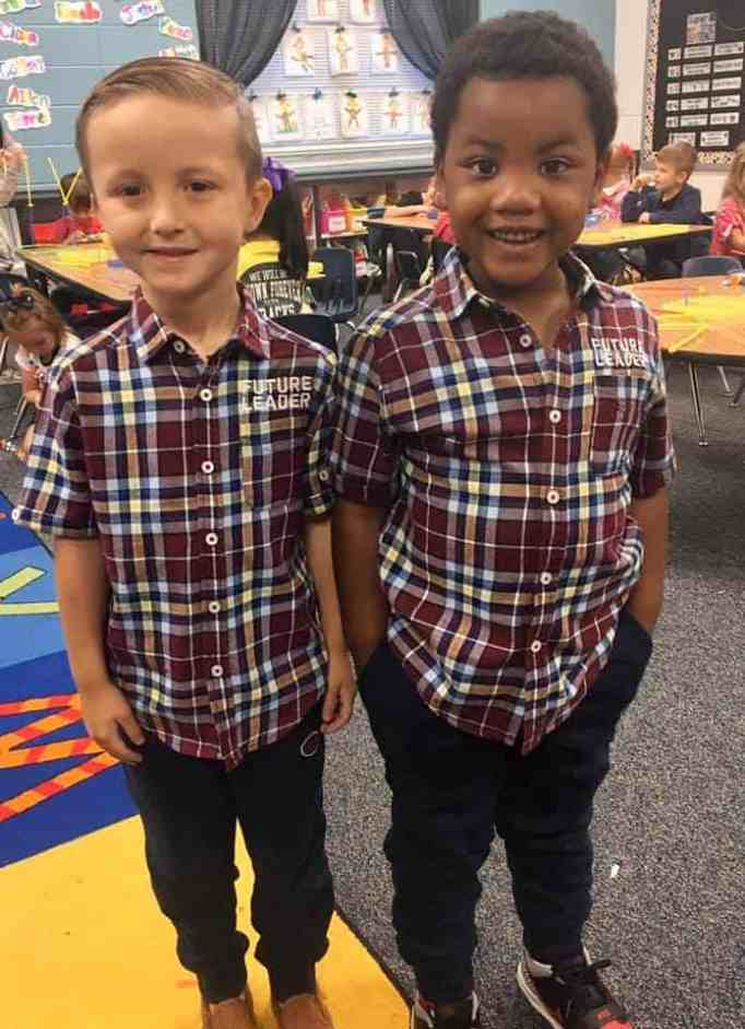 Adorable 'twins' wear matching clothes.