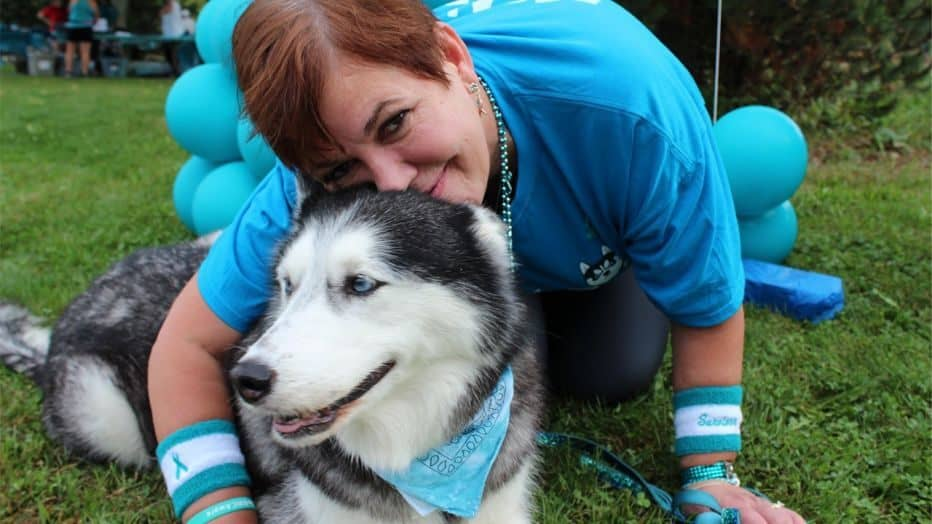 Stephanie Herfel with her dog that helped in detecting her ovarian cancer