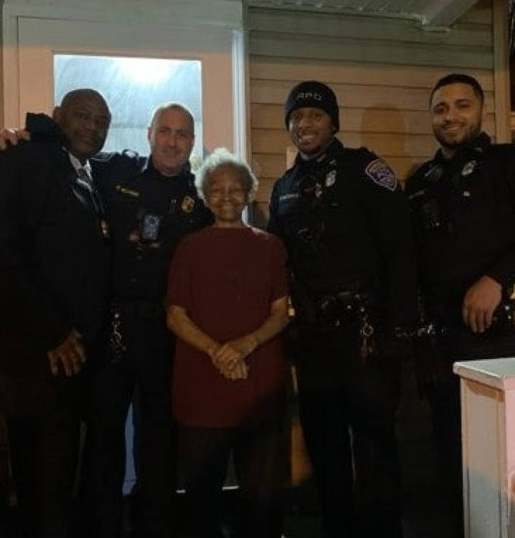 Powerlifting grandma poses with police.