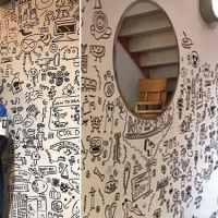 Young boy told not to doodle in class lands job decorating restaurant with his awesome drawings