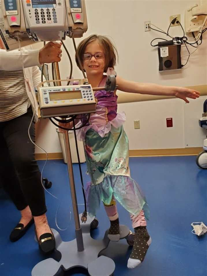 She wears princess gowns to help fight optic pathway glioma.