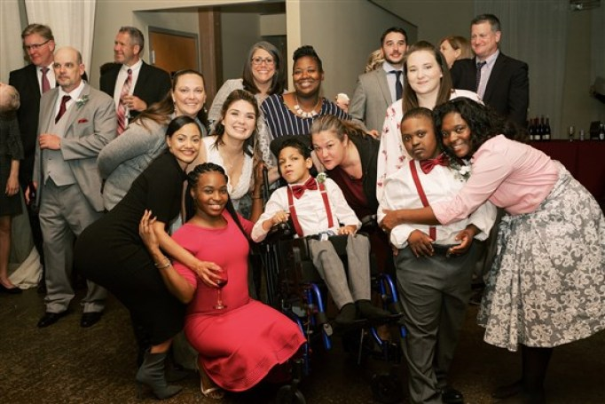 SPED teacher poses with her special needs students at her wedding.
