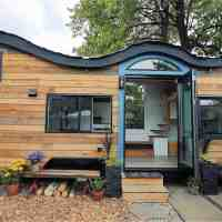 Couple builds eco-friendly tiny home with a spacious full kitchen, take a look inside