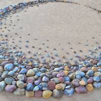Artist stuns beach goers with breathtaking formations of stones found on the beach