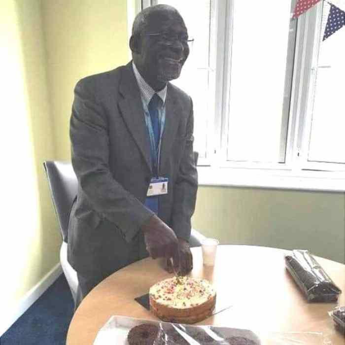 Retired doctor Alfa Saadu cutting a cake during happy times.