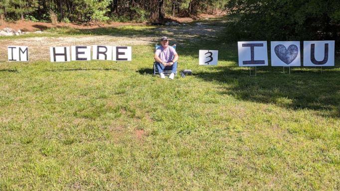 Husband sits outside treatment center.