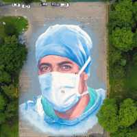 Massive mural of a doctor who died of COVID-19 honors immigrant healthcare workers in NY city