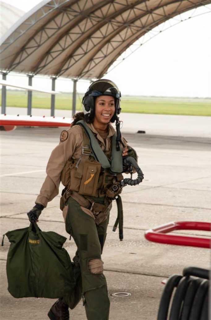 Lt. j.g. Madeline Swegle smiling in her fighter pilot uniform