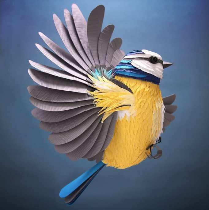 Illustrator creates intricate hand-cut paper sculptures.