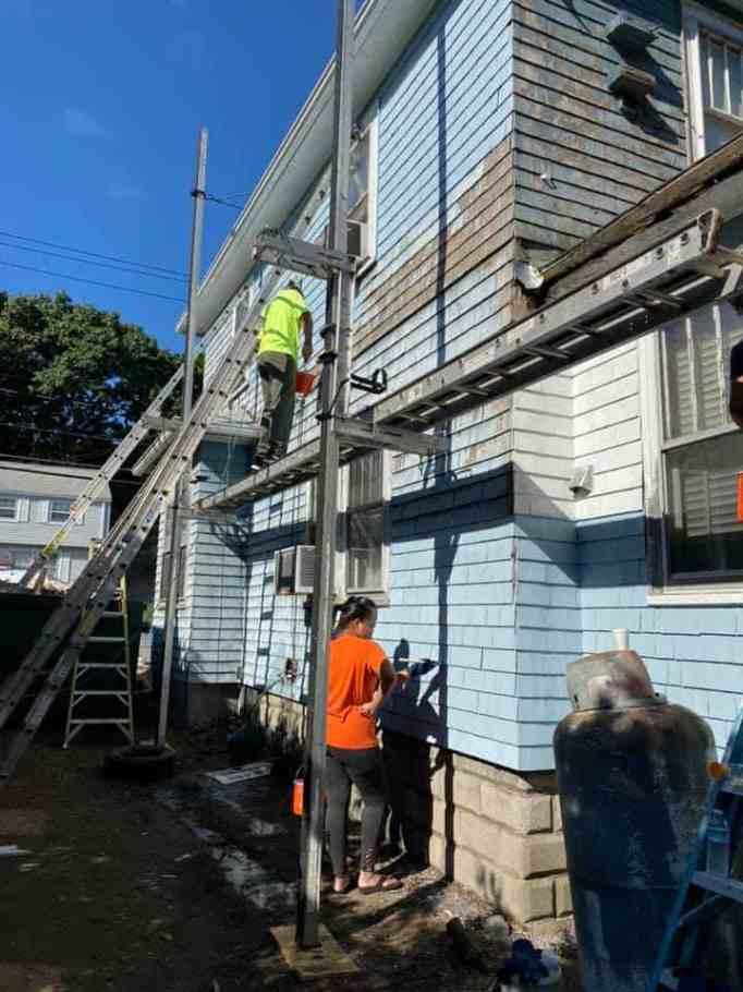 Volunteers repainting a home