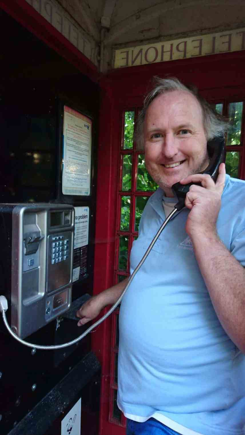 Edmund O'Leary in a phone booth