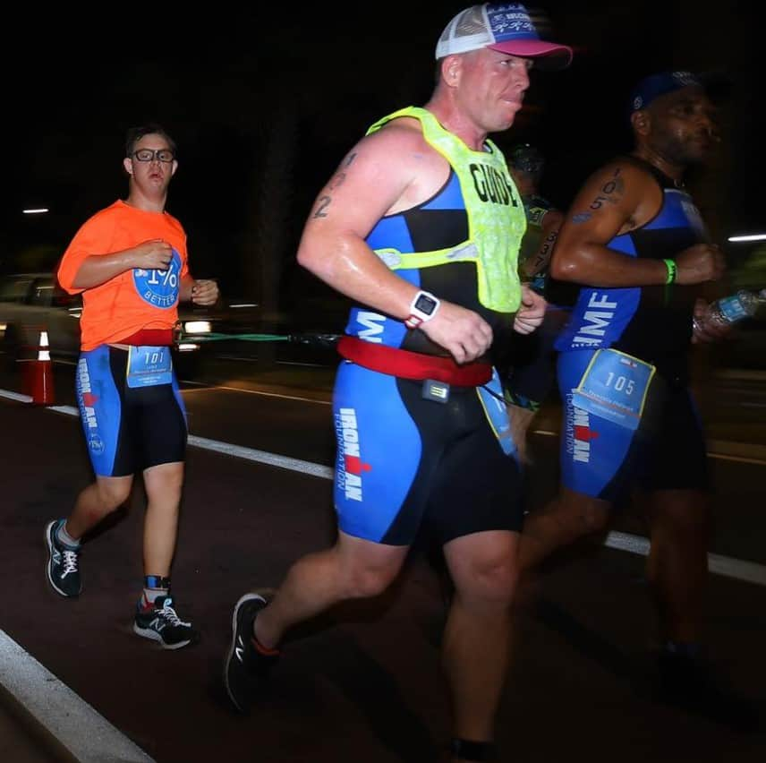The ironman finisher on his way to the finish line.