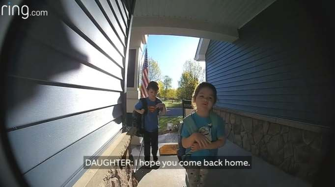 Two kids speaking to their deployed military dad through a Ring doorbell camera