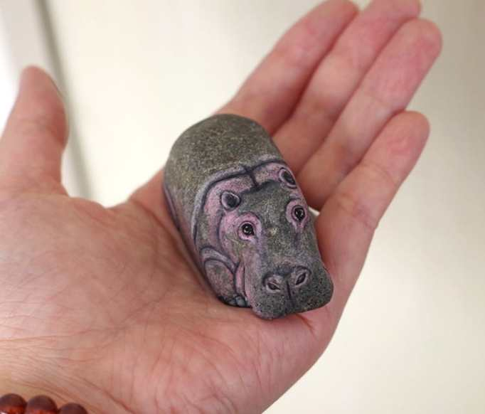 An image of a rhinoceros painted on a stone by Akie Nakata