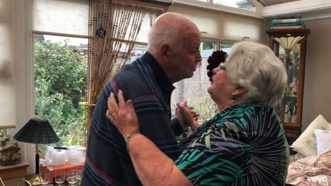 An elderly couple dancing together as they sang Sweet Caroline