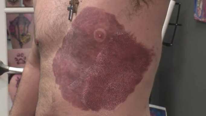 Tattoo made like a birthmark to copy son's.