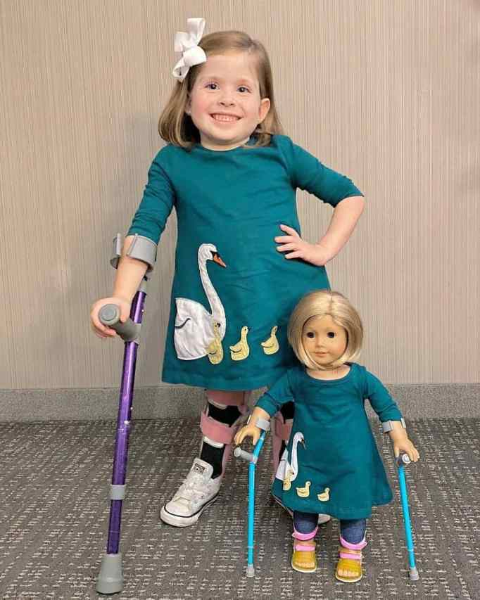 Eliza with her mini me doll