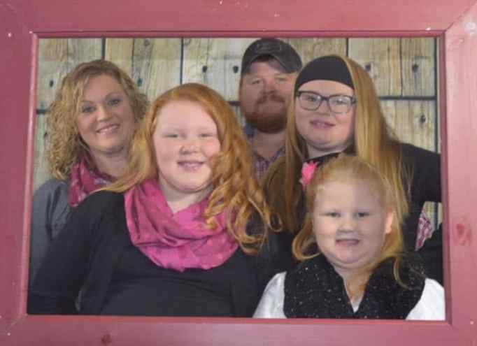 The dairy farming sisters with their parents.