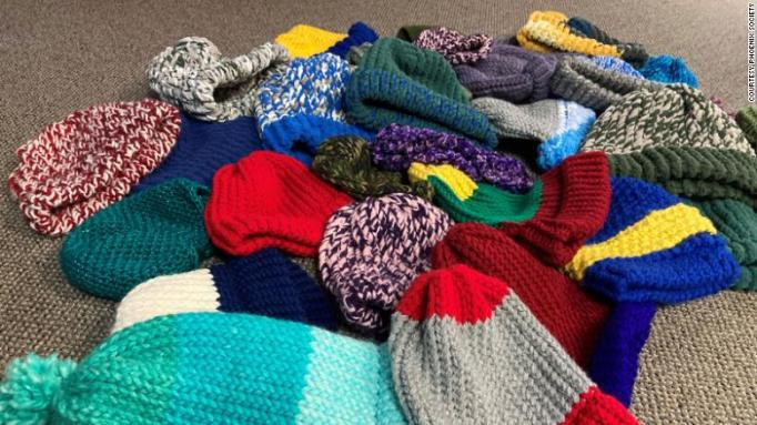 Toques made by the knitting club at Phoenix Society