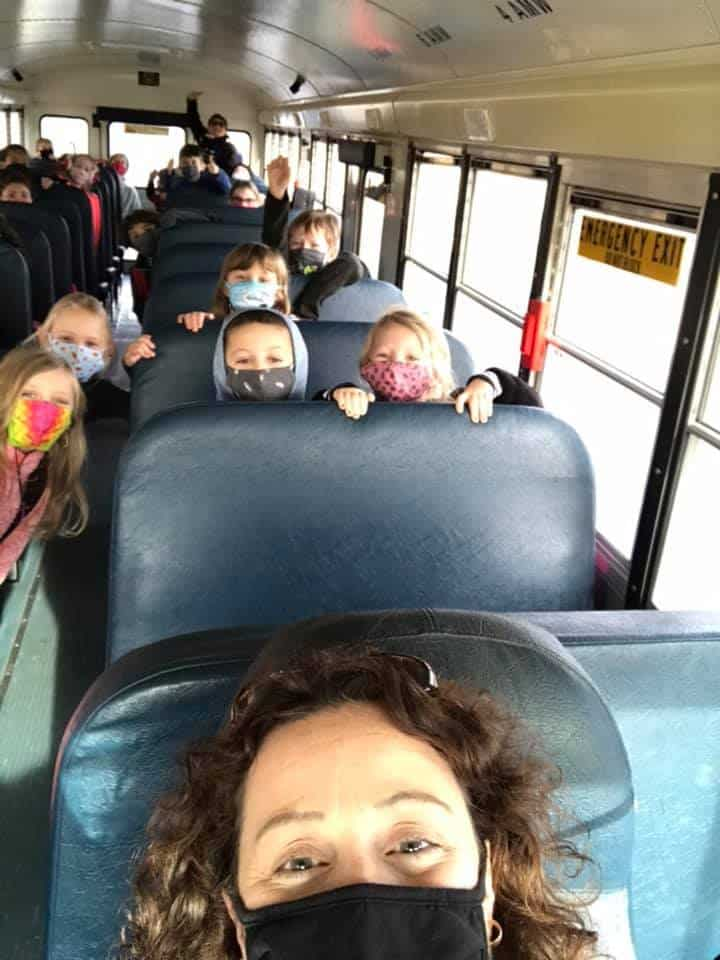Principal Janet Throgmorton with her students on the school bus
