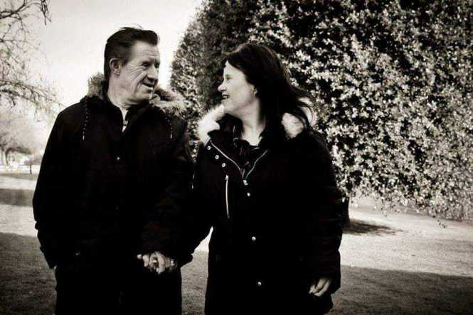 Maryanne and Tommy in black and white photo walking hand in hand.