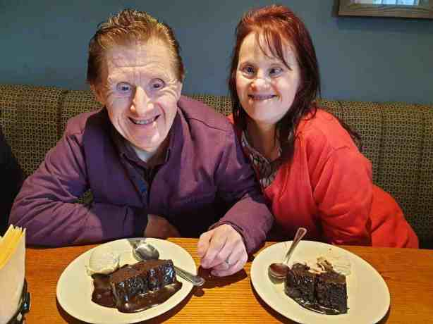 Maryanne and Tommy eating chocolate cake.