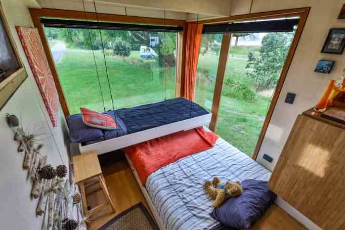 Two beds in a tiny house truck