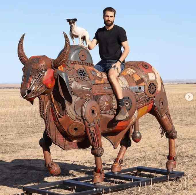 Jordan Sprigg and his best bud, riding one of his unique metal sculptures