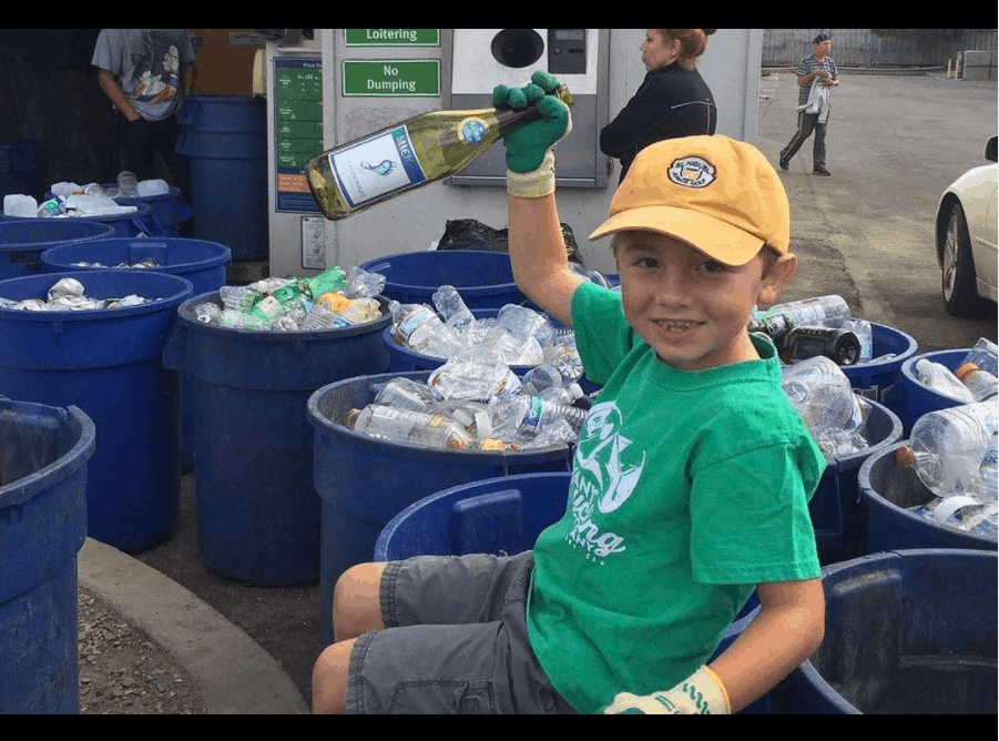 Ryan, sorting through recyclable materials like plastic bottles, glasses, and cans.