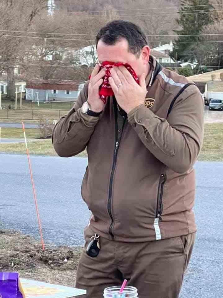 UPS driver Chad Turns wiping his eyes