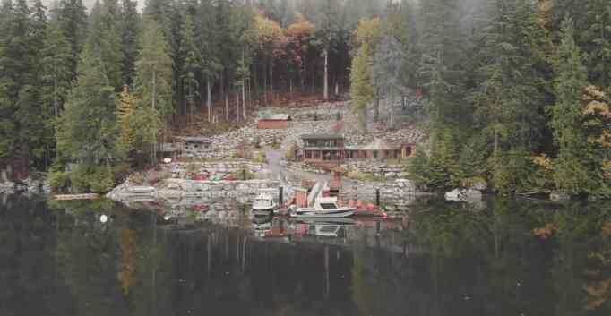 Picturesque view of their off the grid home, accessible only by boat