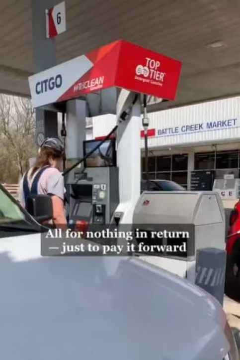 A truck driver in a gas station