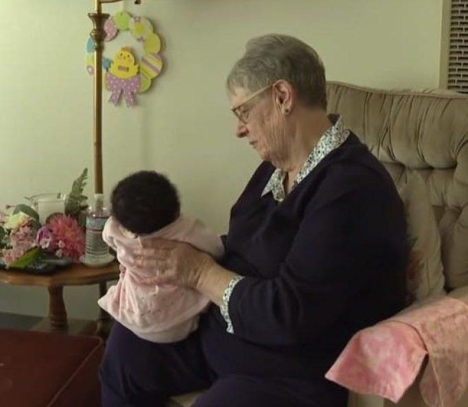 Linda Owens holding an infant