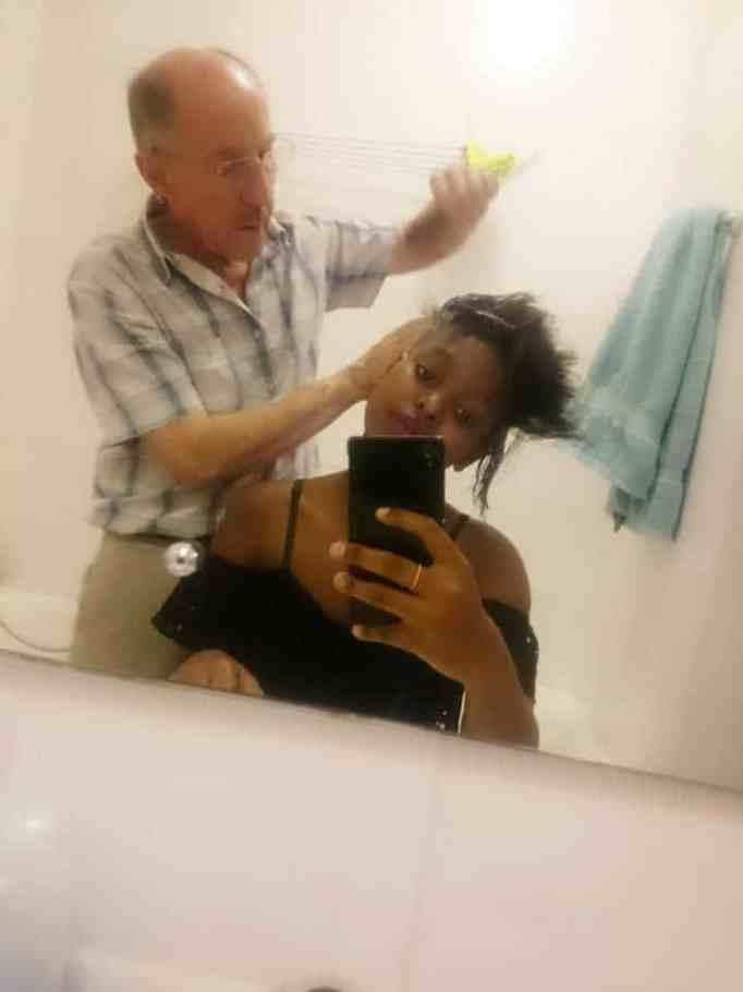 Mandisa Mlitwa's adoptive dad helping her with her hair
