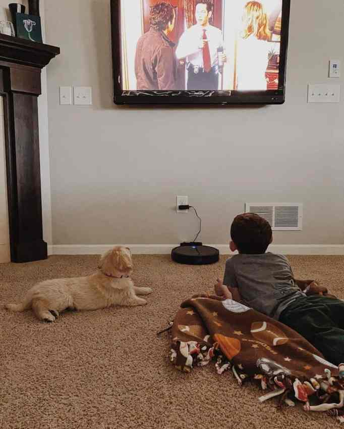 Paxton and Marvel on the floor watching TV together