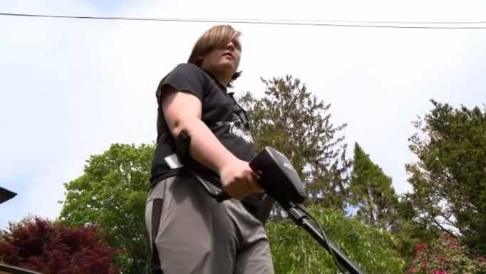 Shane Jones using a metal detector