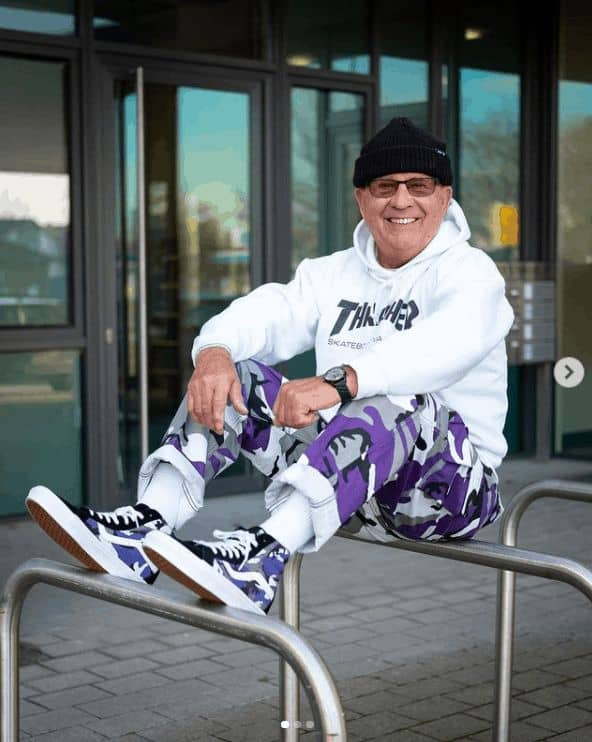 Gramps, smiling gleefully on his comfy streetwear fashion