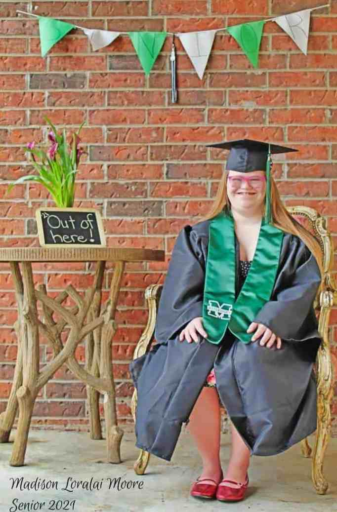 Madison Moore wearing her cap and gown during her graduation