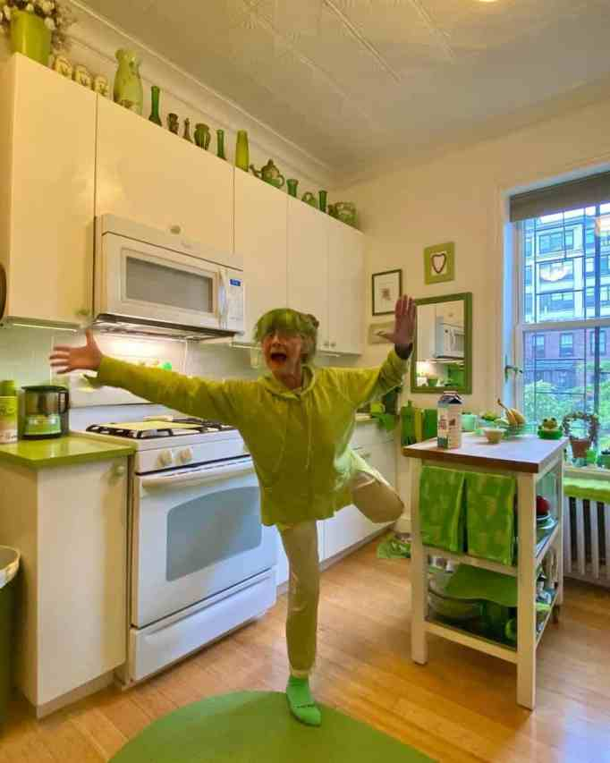 Her kitchen actually has white walls and wooden floors.