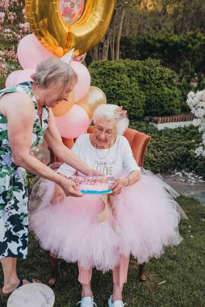 A grandma receiving her birthday cake