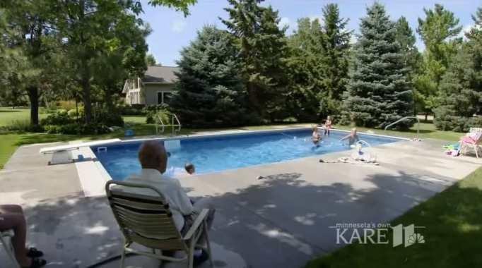 Keith Davison sitting on his lawn chair while watching kids swim in his backyard pool