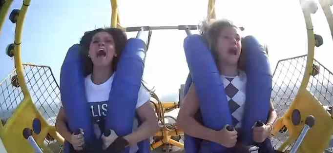 Kiley Holman and Georgia Reed screaming while on the slingshot ride