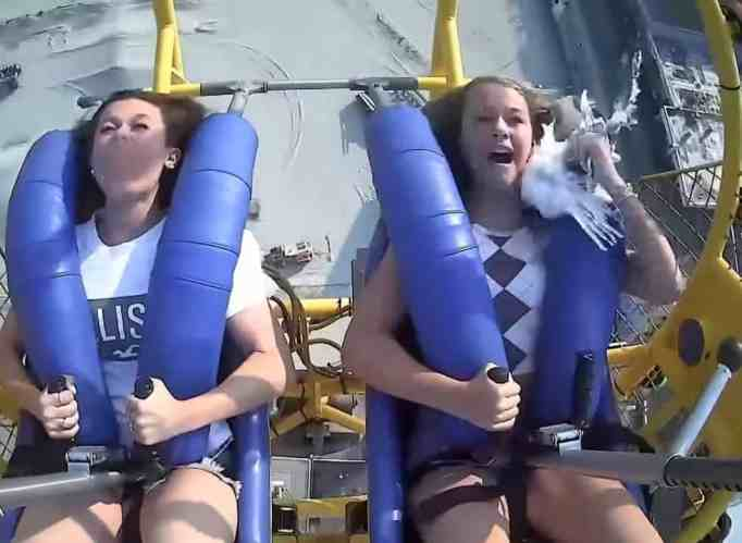 Kiley Holman yanking the seagull off her face while on a slingshot ride
