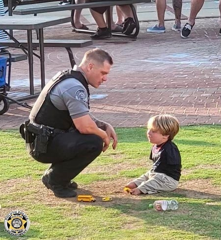 Officer Rolf Seiferheld and Harrison Humphries talking to each other