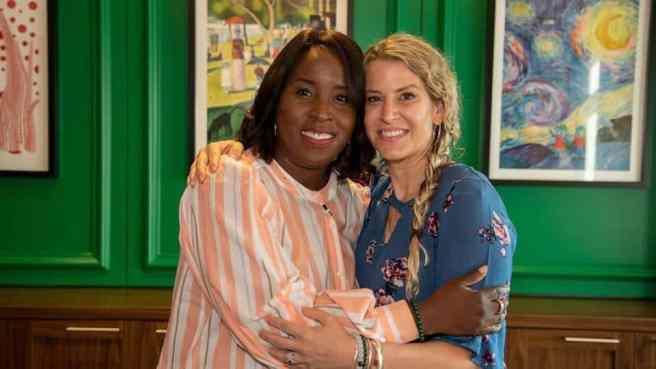Tia Wimbush and Susan Ellis hugging