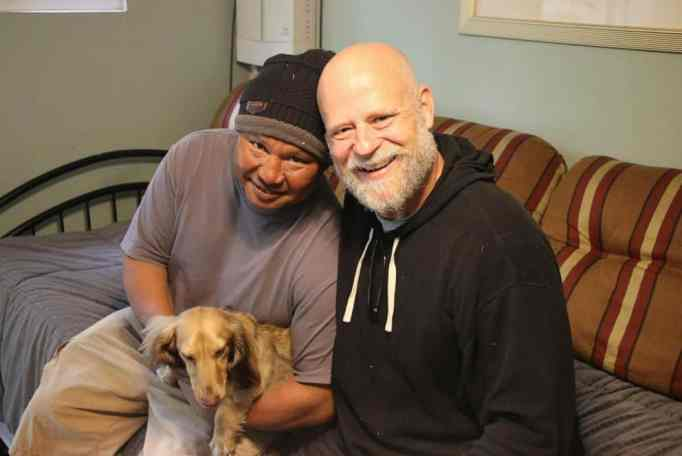 Scott and Robert with a puppy