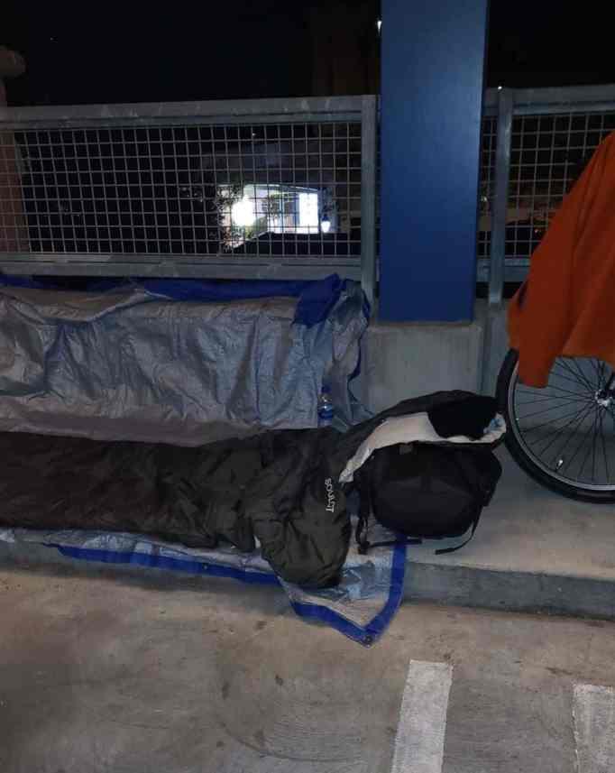 Scott sleeps on the street with Robert