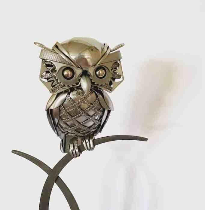 An owl sculpture made from metal