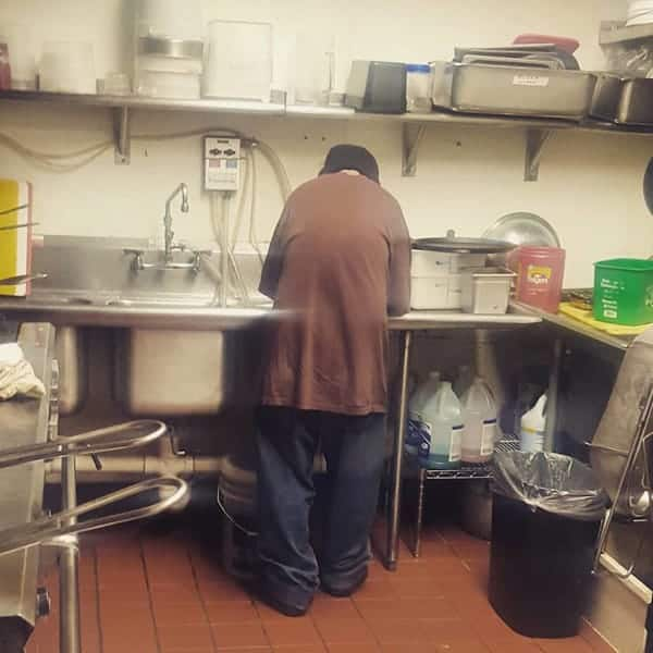 Marcus washing the dishes
