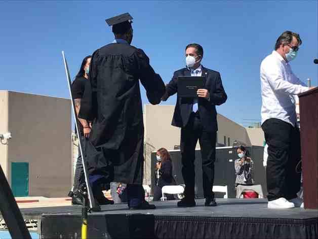 An inmate receiving his diploma